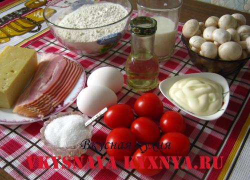Пицца с сыром, ветчиной, грибами и помидорами