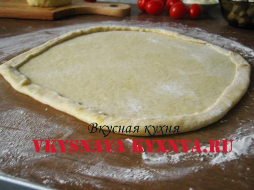 Загнутые края у теста для пиццы